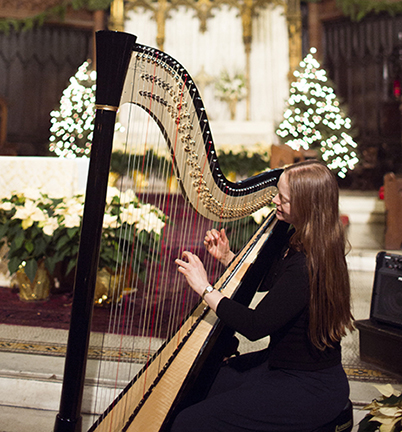 harpist Erin Hill playing for a Manhattan wedding ceremony at Holy Trinity Church