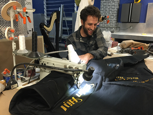 Erin Hill's harp cover being repaired by David Taylor