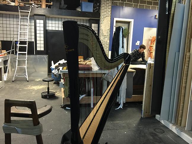David Taylor repairing harpist Erin Hill's harp cover